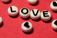 Love text on red Stock Images