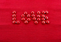Love text shaped candies Stock Images