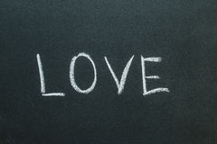 Love text written on chalkboard Royalty Free Stock Images