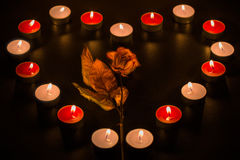 Love them. Heart composed of candles with a flower inside Stock Images