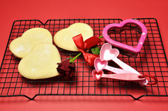 Love theme, baking heart shape shortbread cookies. Stock Photos