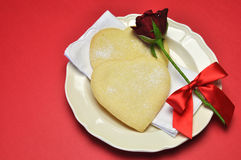 Love theme heart shape shortbread cookies with red rose. Royalty Free Stock Images