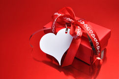 Love theme red present with heart gift tag Royalty Free Stock Image