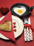 Love theme Valentine breakfast with heart shape egg and toast, vertical. Royalty Free Stock Photos