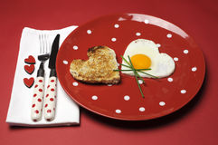 Love theme Valentine breakfast on red polka dot plate Stock Images