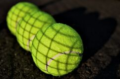 The Love for Three Tennis Balls Royalty Free Stock Photography