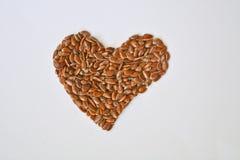 Love Thy Flax. A Heart Shaped Heap of Flax seeds Stock Photos