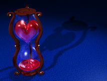 Love time. An computer generate hourglass that have a liquid heart inside Stock Photos