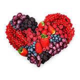 With love to berries. Creative valentine concept photo of a heart made of berries on white background Royalty Free Stock Photos