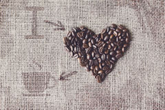 Love to coffee - Burlap texture with beans heart shape Royalty Free Stock Photography