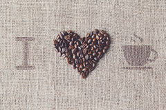 Love to coffee - Burlap texture with beans heart shape Royalty Free Stock Photo