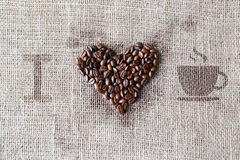 Love to coffee - Burlap texture with beans heart shape Stock Photos