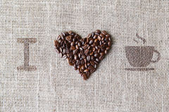Love to coffee - Burlap texture with beans heart shape Royalty Free Stock Photos