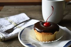 Cupcake on the wood background. We love to eat cupcake with coffee in coffee time Stock Image