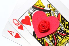 Love to gamble. Black Jack poker cards with red heart and rose. Concept for love to gamble. on white background stock photography
