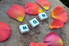 Love to mother. Children laid out the letters MOM royalty free stock photography