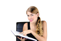Love to Read. Portrait of a pretty young female reading a book Stock Photo