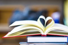Love to reading books concept : Stack of books and open book hea stock photos