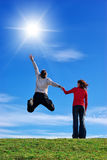 Love to Sun. Couple on meadow and sunny sky Stock Images