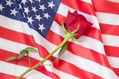 Love to those who have sacrificed their lives for us with a rose and an American flag. An American flag and a rose honors those who have sacrificed their lives stock photos