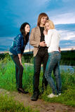 Love triangle. Boy and two girls find out the relationship Royalty Free Stock Photos