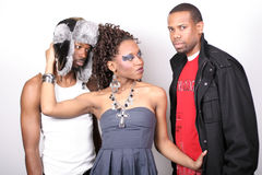 Love Triangle. A man and woman standing against a white background Royalty Free Stock Image