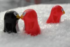 Love triangle or being third wheel. Having affair, infidelity or cheating concept. Unrequited love concept. Valentine`s day concept. Three toy penguins in the royalty free stock photos