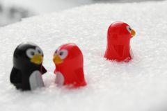 Love triangle or being third wheel. Having affair, infidelity or cheating concept. Unrequited love concept. Valentine`s day concept. Three toy penguins in the stock photos