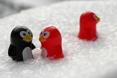 Love triangle or being third wheel. Having affair, infidelity or cheating concept. Unrequited love concept. Valentine`s day concept. Three toy penguins in the stock images
