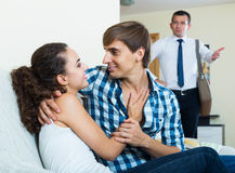 Love triangle: husband, wife and lover at domestic interior Royalty Free Stock Photography