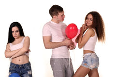 Love triangle. Man and two women. Royalty Free Stock Image