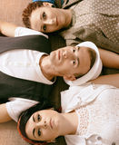 Love triangle young guy before a choice in resistance of two gir Royalty Free Stock Photography
