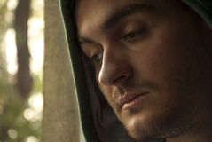Love trouble. Portrait of young worried man looking through window royalty free stock images