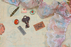 Love and trust background. Made with vintage trinkets and lace Royalty Free Stock Photo