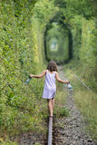 Love tunnel Romania. A small girl on the tracks of the Love tunnel near Caransebes, Romania Royalty Free Stock Image