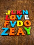 Love twice. Love appearing twice in a grid of colourful letters Royalty Free Stock Image