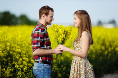 Love for two. On a fine spring meadow Royalty Free Stock Photo