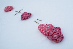 Love. Two  red hearts together in the snow. Royalty Free Stock Photography