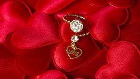Love Typed in a Heart with a diamond ring. Love Typed in a Heart on red hearts with a diamond ring Royalty Free Stock Photos