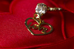Love Typed in a Heart. Love Typed in a Heart on hearts with a blurry diamond ring behind it Royalty Free Stock Photos