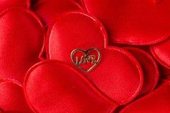 Love Typed in a Heart. Love Typed in a Heart on red hearts Royalty Free Stock Photo