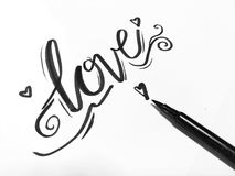 Love. Typography with brush pen Stock Photo