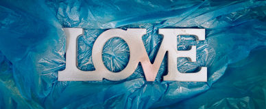 LOVE typography - Just painted white sign in honor of Valentine`s Day Stock Image