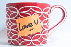 Love U Mug. Red Mug with Love you orange sticker Stock Photography