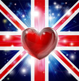 Love UK flag heart background. Union Jack patriotic background with pyrotechnic or light burst and love heart in the centre Royalty Free Stock Images