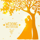 Love under the tree. Wedding card with romantic silhouette of loving couple at sunset under tree Stock Images