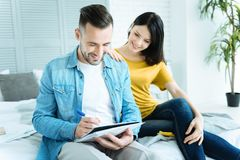 Mindful lady looking at boyfriend working at home Royalty Free Stock Photo