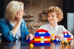 Smart curly haired kid spending time with grandmother Stock Images
