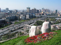 Love in urumqi. A bird's-eye view of Urumqi city,Xinjiang,China.Took this image in the Red Mountain park's peak,and there are two stone with chinese characters Royalty Free Stock Photography