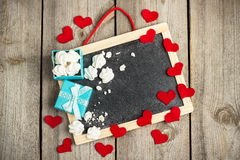 Love and Valentine Day decoration with hearts, frame, gift box Royalty Free Stock Photos